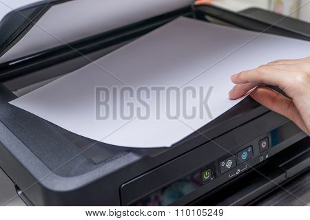 Close up Woman's hand with working copier printer