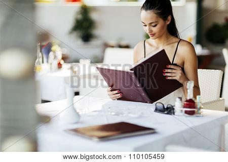Beautiful Woman Ordering From Menu