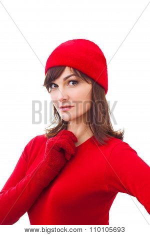 Serious winter girl in red hat, mittens  over white background