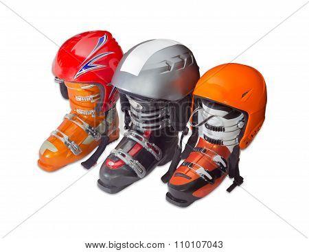 Three Alpine Ski Boots And Ski Helmets