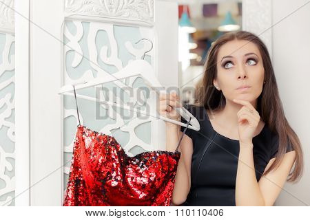 Surprised Girl Trying on Red Party Dress in Dressing Room