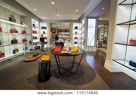 SINGAPORE - NOVEMBER 08, 2015: interior of Coach store. Coach, Inc. is known for accessories and gifts, including handbags, bags, small leather goods, footwear, outerwear and other accessories