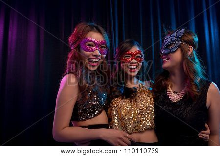 Girls in masquerade masks