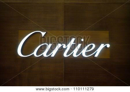 SINGAPORE - NOVEMBER 08, 2015: Cartier inscription. Cartier designs, manufactures, distributes and sells jewellery and watches. Founded in Paris.