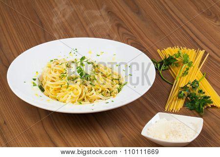 Spaghetti aglio e olio dish on a wooden table.