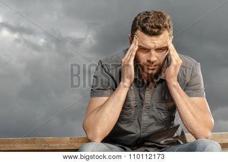 Thoughtful, depressed, handsome man
