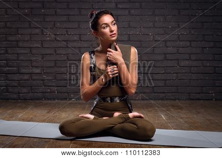 Beautiful Girl Doing Yoga Exercises And Holding Book