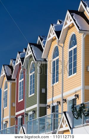 A winter view row of colorful new townhouses or condominiums.