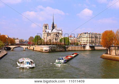 Passenger cruise at Cathedral Notre Dame river Seine Paris France