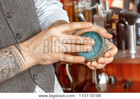 Barbers hand and a gel jar
