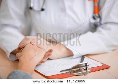 Doctor consoling or supporting patient