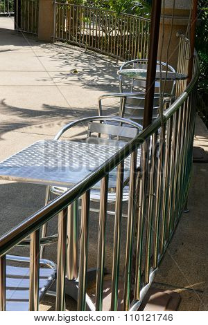 Metal Chair And Desk On The Balcony