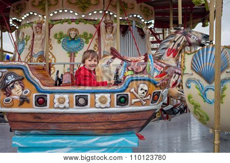 Sweet Boy, Riding In A Train On A Merry-go-round, Carousel Attraction In Europe, Active Children