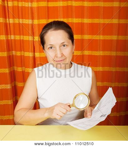 Mature Woman Looking At Utility Bills