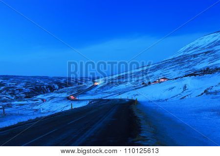 Winding road at dusk in winter, Northeast of Iceland. The Ring Road (Route 1) of Iceland, near  Egilsstadir.