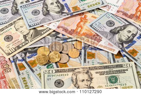 Russian Rubles Coins And Us Dollars Banknotes As Background