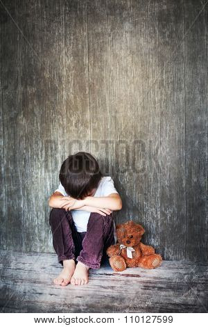 Young Boy, Sitting On The Floor, Teddy Bear Next To Him, Crying