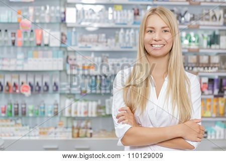 Beautiful pharmacist standing in a drugstore