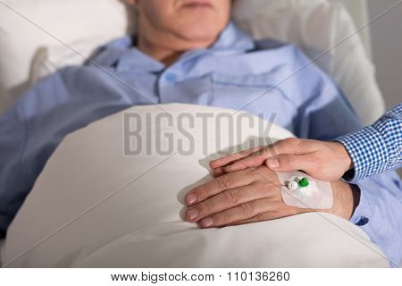 Caregiver Holding Patient's Hand