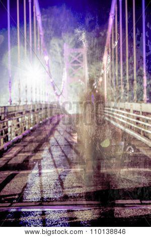 Shadowy Figure Walking On Defocused Bridge