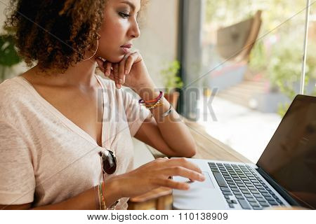 Young African Woman Working In Coffee Shop