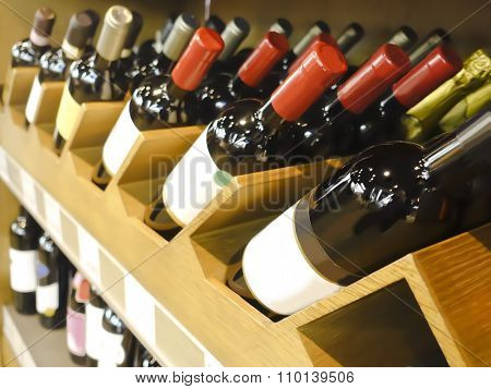 Wine bottles in wooden boxes are on the table restaurant.