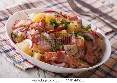 Potato Salad With Bacon Soaked In Mustard Sauce Close Up. Horizontal
