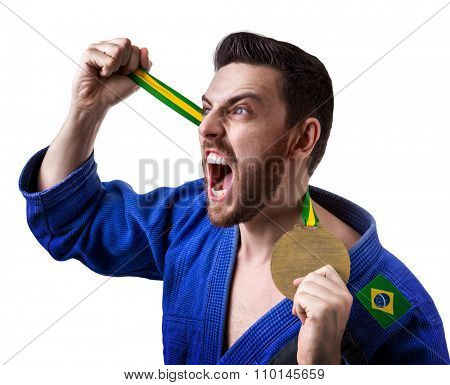 Brazilian judoka fighter man holding a medal isolated on white background