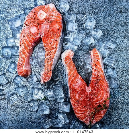 Raw Trout Stakes And Ice On Metal  Background.