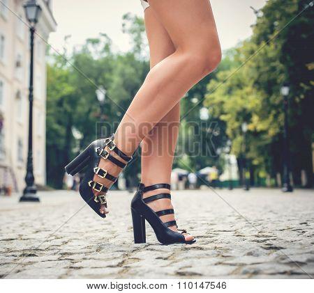 beautiful woman legs in high heel shoes outdoor shot