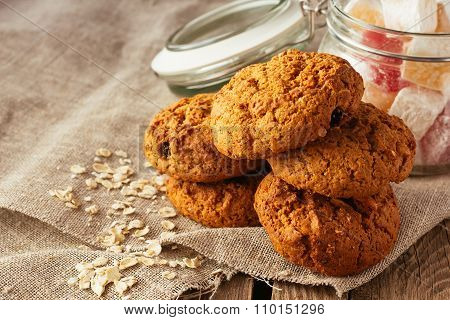 Oatmeal Cookies And Jar With Sweeties On Linen Cloth