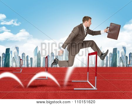 Man hopping over treadmill barrier with city