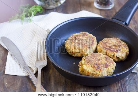 Burger (cutlet) In The Frying Pan. Burger (cutlet) in the frying pan on the wooden table