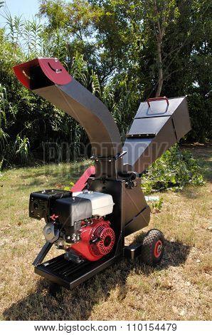 A garden shredder with petrol engine