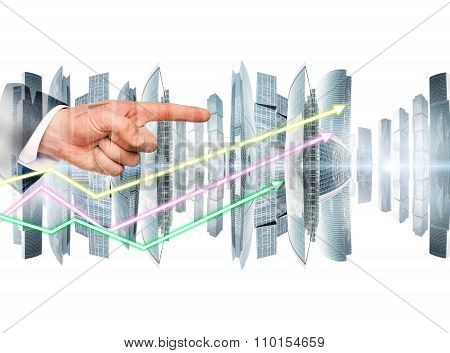Businessmans hand with arrows and city