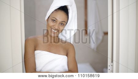 Portrait of young woman with white towel in bathroom