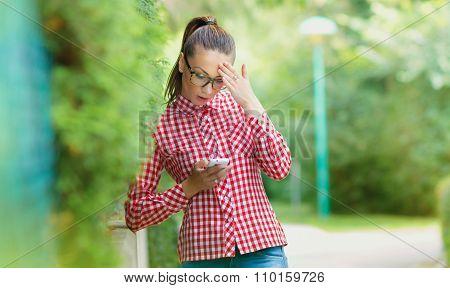 Astonished Young Girl With Phone