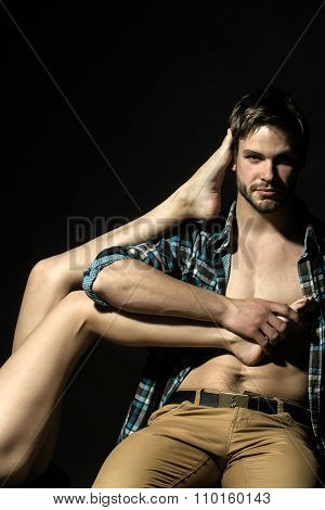 Man Holding Female Legs