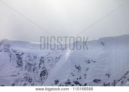 Sunlight Off-piste Slope In Mist