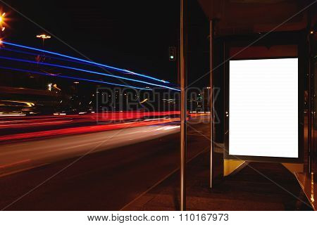 Empty poster in urban setting at night