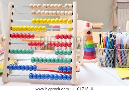 Wooden abacus with many colorful beads