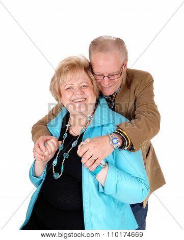 Senior Man Hugging His Wife.