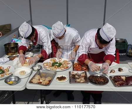 Three Chefs At A Cooking Competition