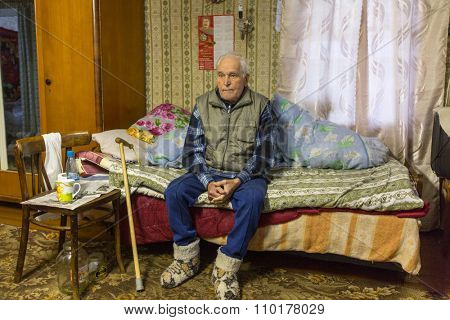 VINNITSY, RUSSIA - NOV 30, 2015: Elderly man Veps - small Finno-Ugric peoples living on the territory of Leningrad region in Russia. According to the 2002 census, there were 8,240 Veps in Russia.