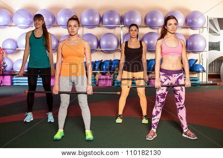 women doing a leg exercise in aerobics class