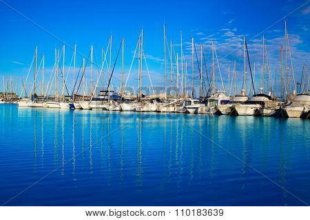 Denia marina port in Alicante Spain with boats in a sunny blue day