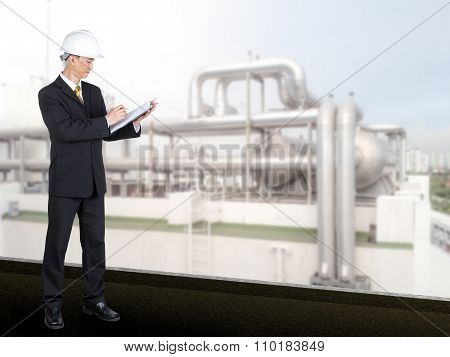 Asian Engineer Checking List Cooling System In Building