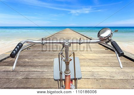 Front Part Of Vintage Bicycle. View From Bikers Eyes On Wood Bridge At The Sea