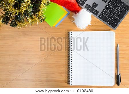 office desk with christmas accessories and stationery, view from above