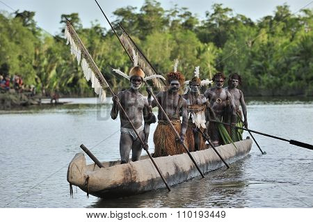 Canoe War Ceremony Of Asmat People. Headhunters Of A Tribe Of Asmat . New Guinea Island, Indonesia.